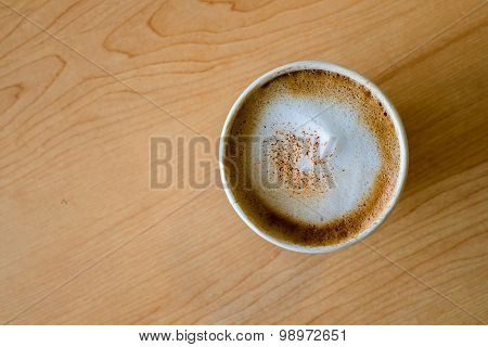 Top View Of Hot Capuccino Coffee In Paper Cup