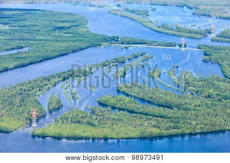 Country road in flooded forest plain