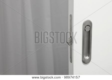 Bathroom Metallic Doorknob With Lock Over A White Door