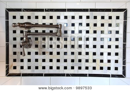 Pot filler faucet in the wall.