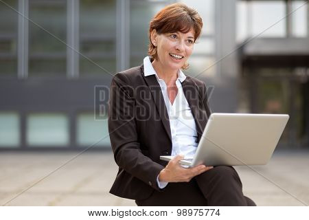 Businesswoman Sitting Thinking With Her Laptop