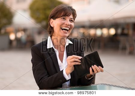 Laughing Vivacious Woman Making A Payment
