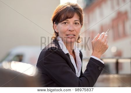 Woman Smoker With A Guilty Expression