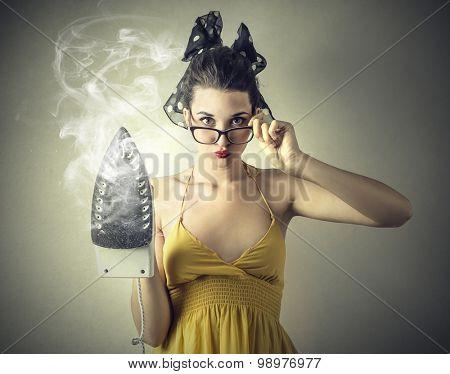 Desperate girl doing the ironing