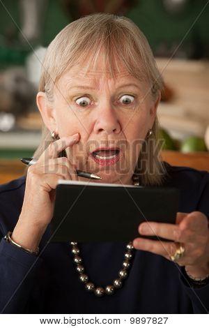 Senior Woman With Checkbook