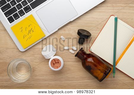 On-line treatment  anti stress concept with bottles of medicine pills on the table