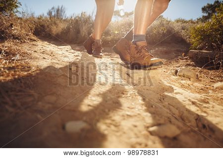 Young People Hiking On A Sunny Day