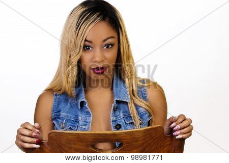 Black Woman Wearing Denim Vest Open Sitting