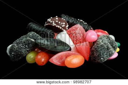 Pile of candy isolated on black background