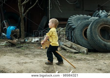 boy playing with wooden horse