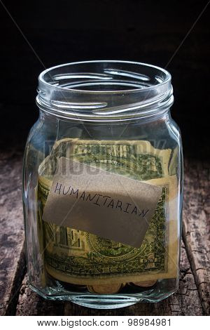 Jar For Collection Of Funds In Need On A Wooden Background