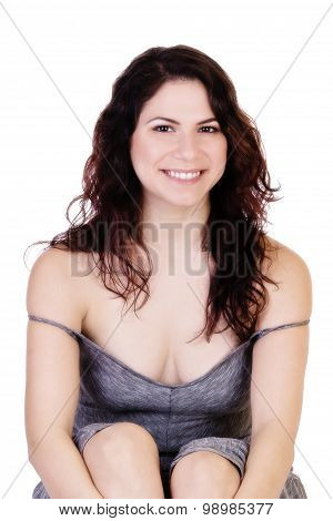 Smiling Brunette Caucasian Woman Sitting Showing Cleavage