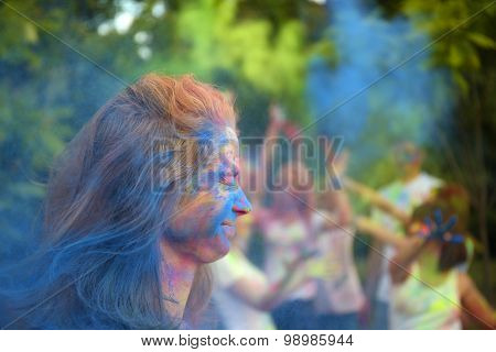 Young people celebrate Holi color festival in park