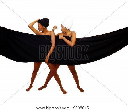 Two Black Sisters Standing Behind Black Cloth