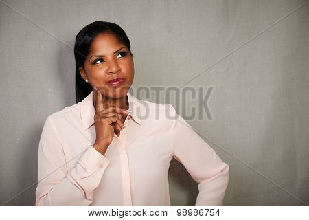 Young Businesswoman Planning With Hand On Chin