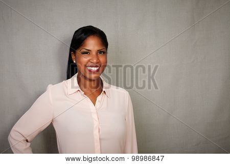 African Woman Standing Against Grey Background