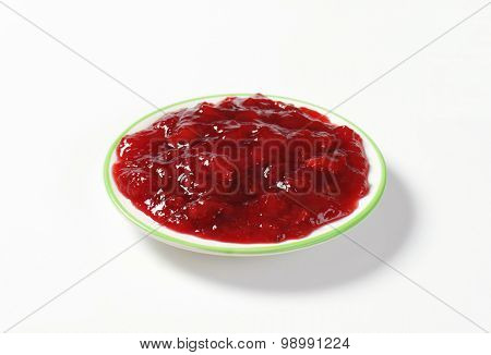 strawberry jam on white plate