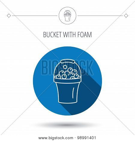 Bucket with foam icon. Soapy cleaning sign.