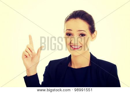 Beautiful happy businesswoman showing size with her fingers.