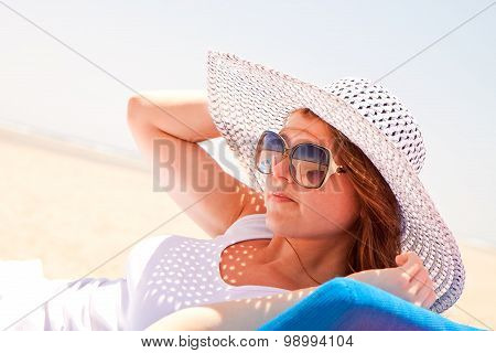 Woman In A Hat On The Beach