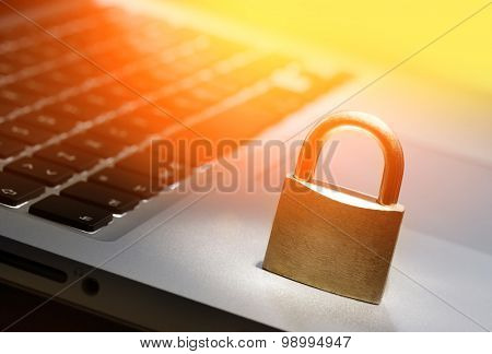 Lock on laptop keyboard with shallow depth of field