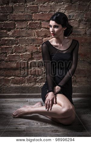 girl sitting on the brick wall background