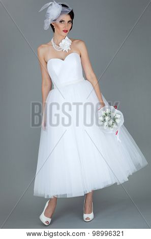 bride in a white dress on a gray background