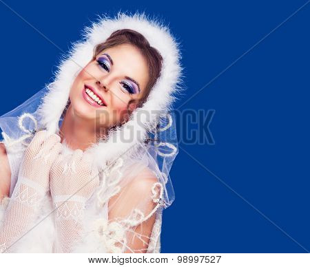 beautiful woman , winter topic, isolated against blue background