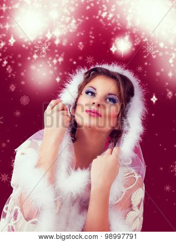 beautiful surprised woman against red background, Christmas topic