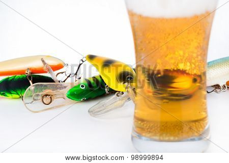 Fishing Bait Wobblers Near Glass With Beer