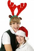 foto of christmas hat  - adorable teen couple in christmas hats - JPG