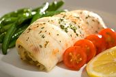 stock photo of flounder  - Gourmet dinner of crab stuffed flounder with cherry tomatoes and green beans - JPG