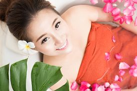 pic of beauty parlour  - Beautiful female in bath with rose petal - JPG