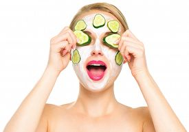 image of cucumbers  - Funny smiling Spa Woman applying fresh Facial Mask with cucumbers - JPG