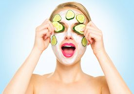 picture of cucumbers  - Funny smiling Spa Woman applying fresh Facial Mask with cucumbers - JPG