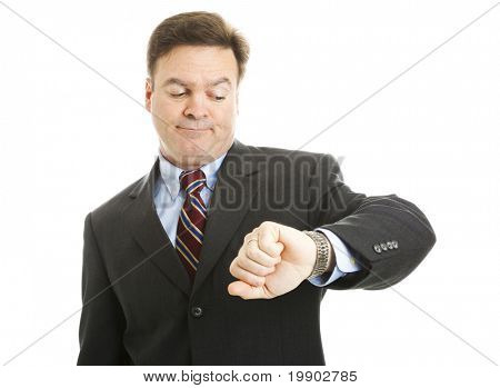 Impatient businessman checks his watch.  Isolated on white.