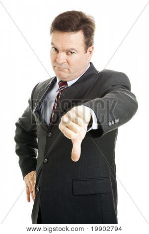 Stern, angry looking businessman or boss giving thumbs down.  Isolated on white.