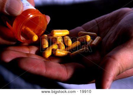Pills In A Hand