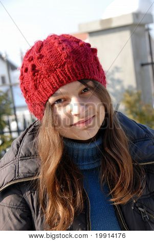 Teenage Girl In Red Cap Portrait