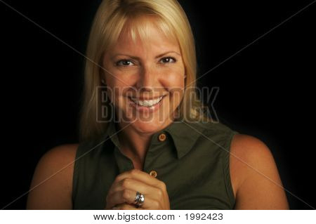 Attractive Portrait Of Blond Haired, Brown Eyed Woman.