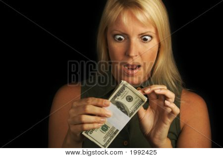 Attractive Woman Holding Stack Of Money.