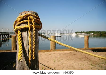 Old Yellow Rope At Marina