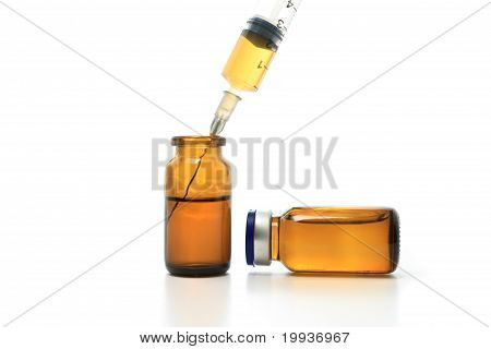 Syringe And Glass Bottles
