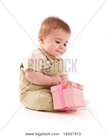 Portrait Of Happy Baby Boy With Small Pink Gift Box