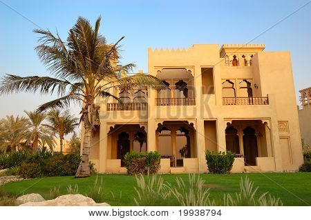 The Arabic Style Villa And Palm During Sunset At Luxury Hotel, Dubai, Uae