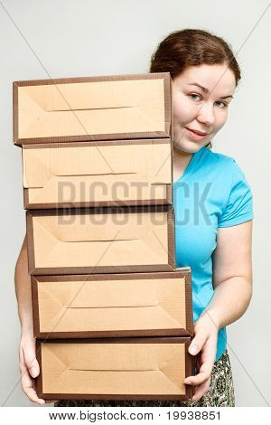 Young Woman Holding Several Carton Boxes