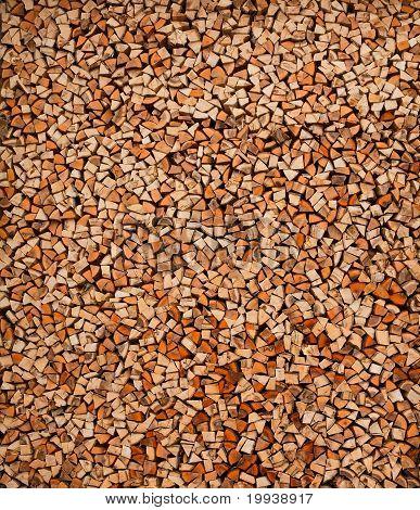 Big rural stack of firewoods. Background