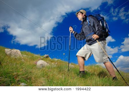 Hiker Climbing A Peak In National Park Pirin