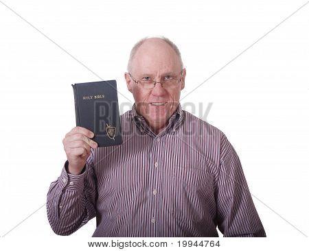 Older Man In Striped Shirt Holding Old Battered Bible