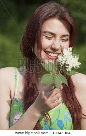 Laughing Young Woman With Flower